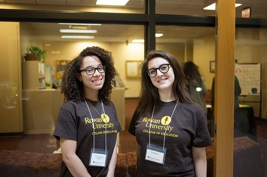 two students standing in front of the advising center